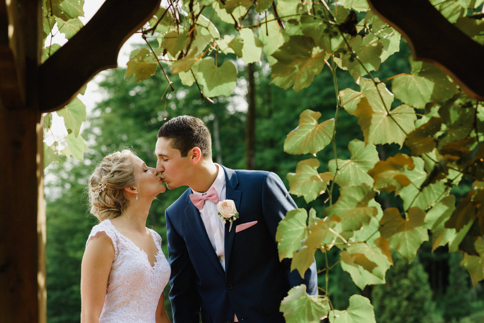 Wedding portrait framed by vines