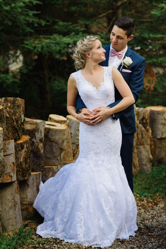 Wedding portrait near rustic logs
