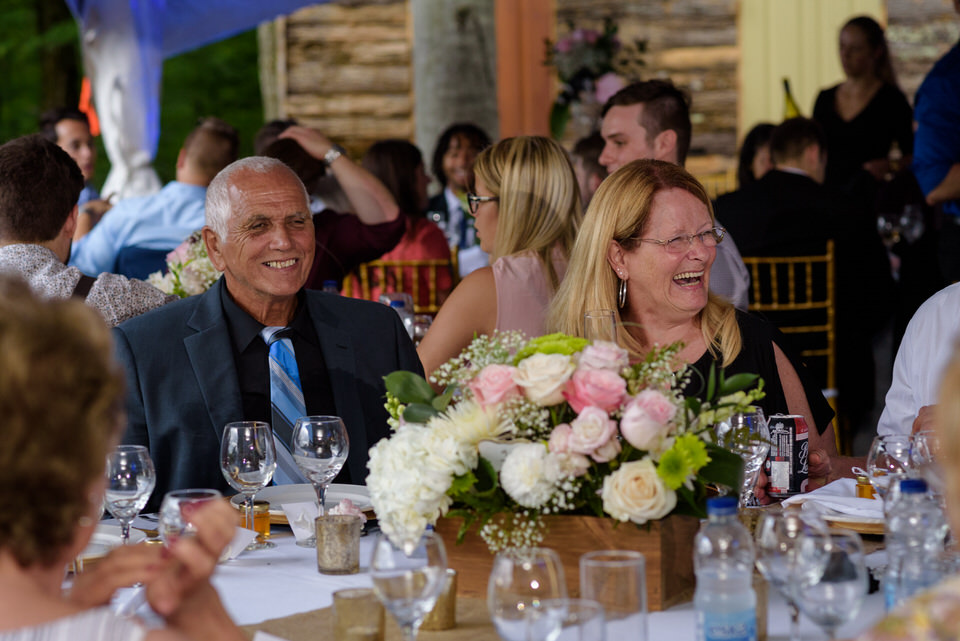Wedding guests laughing at dinner