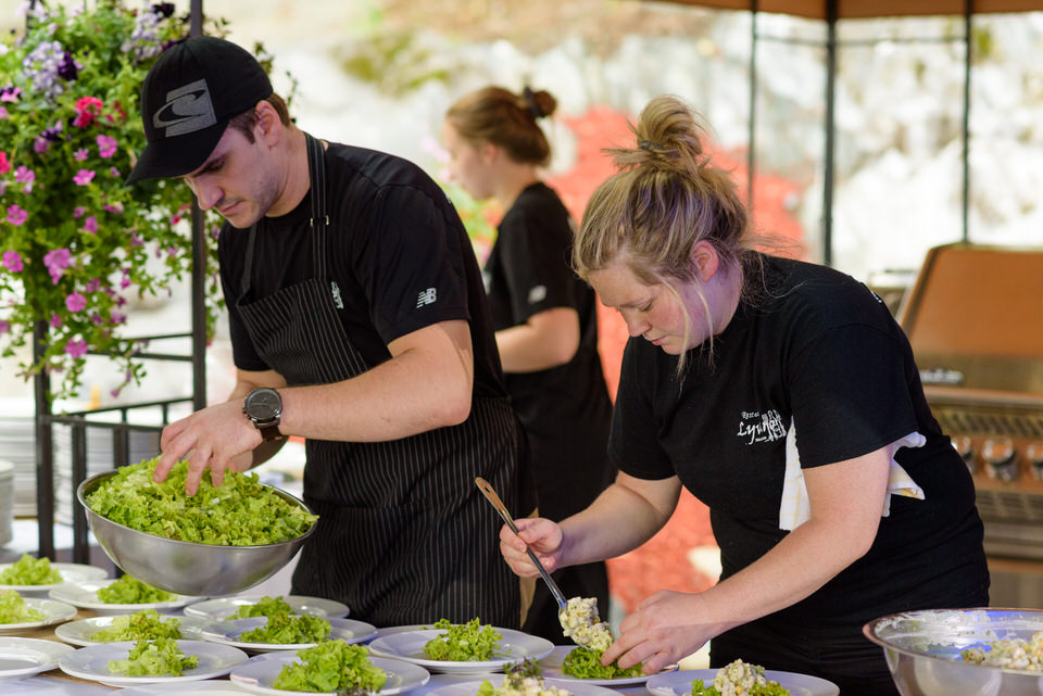 Catering staff from Restaurant Lyvano preparing wedding food