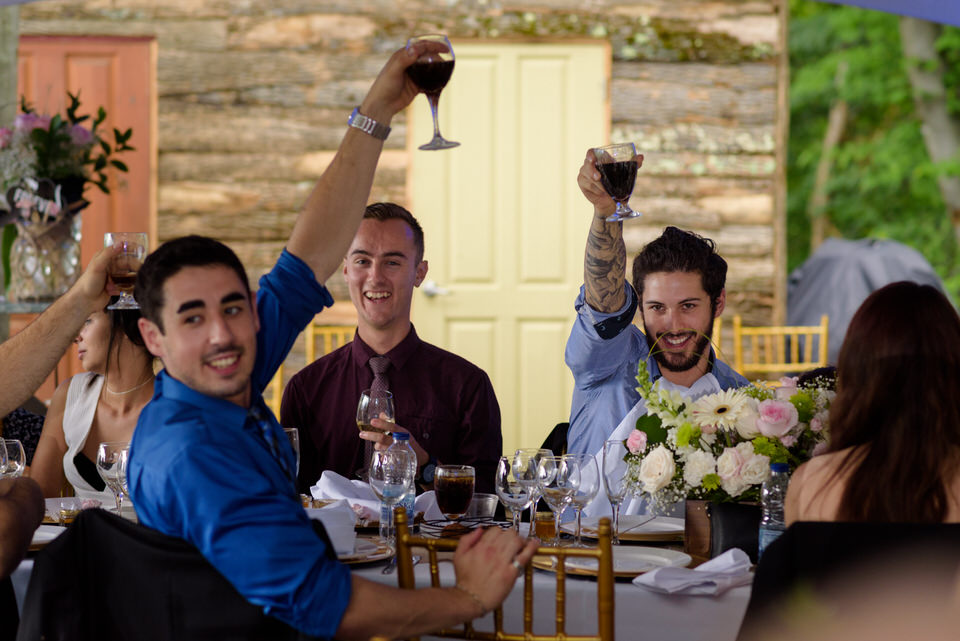 Wedding guests raising glasses in toast