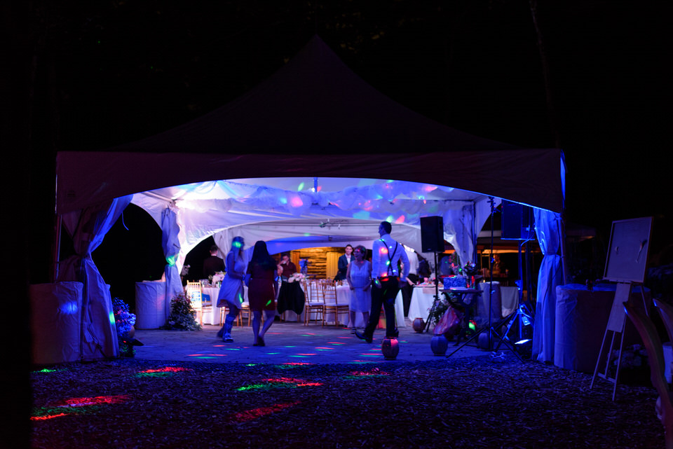 Wedding reception tent at night lit by LEDs