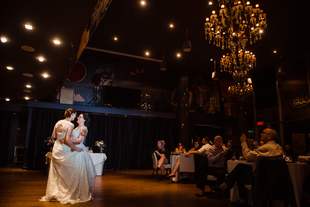 Brides dancing their first dance together at Hotel 10 wedding reception