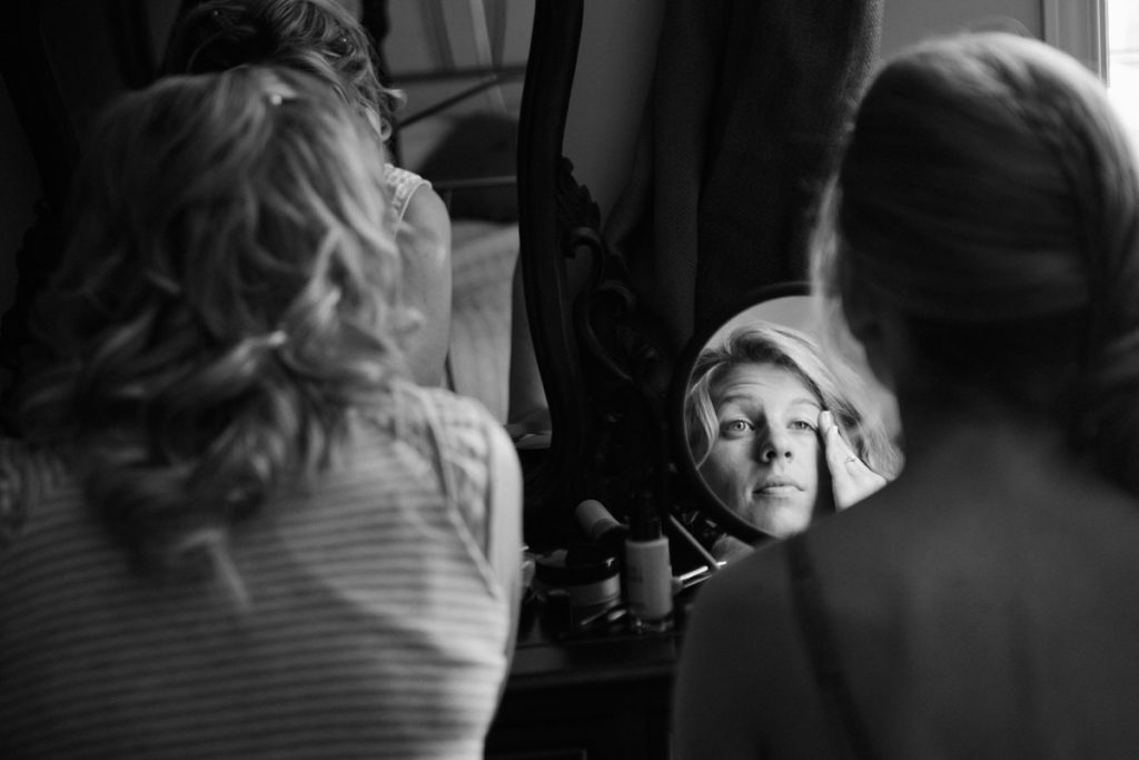 Bride doing her makeup