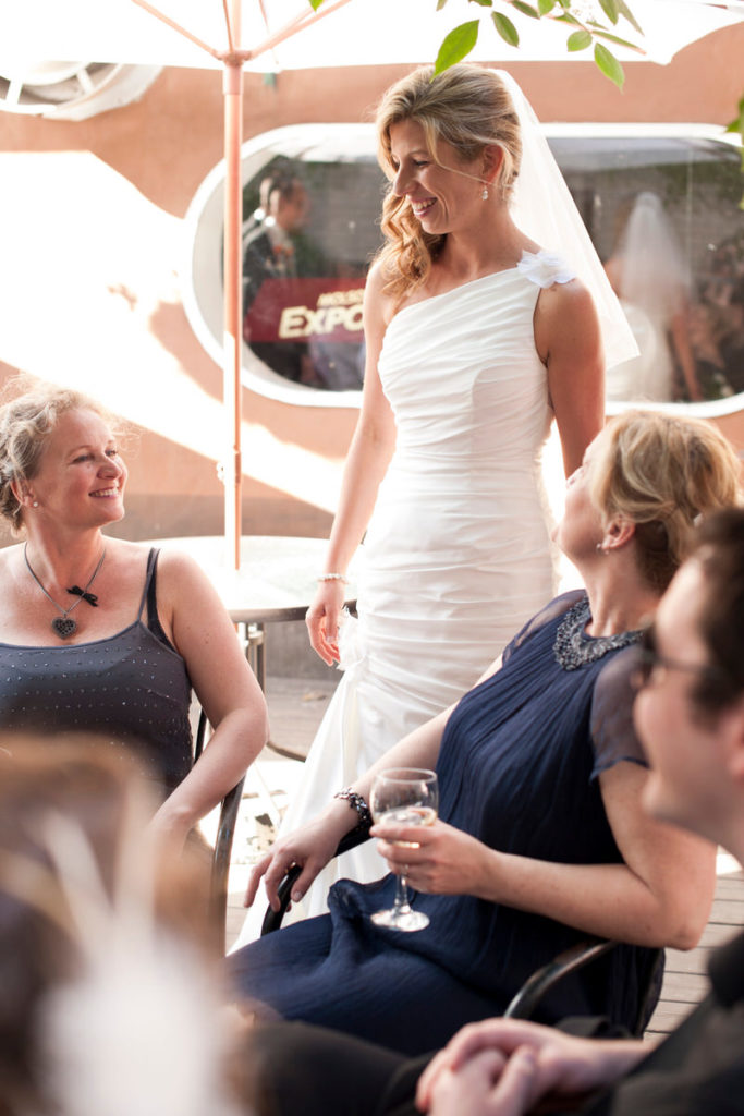 Bride chatting with friends at nearby pub