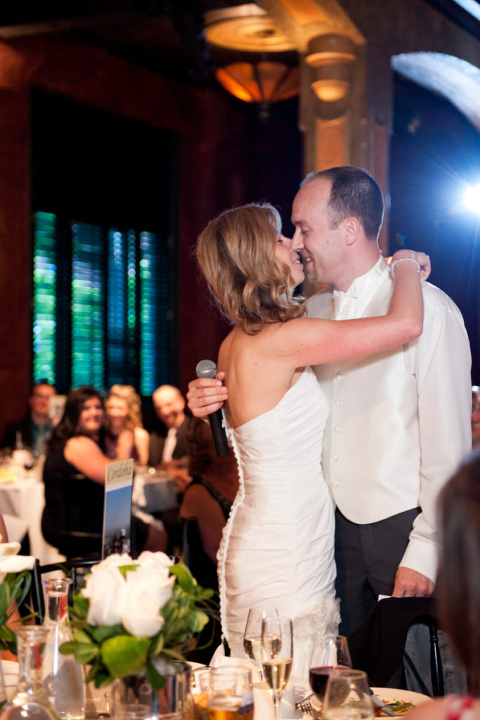 Wedding couple kissing during speech