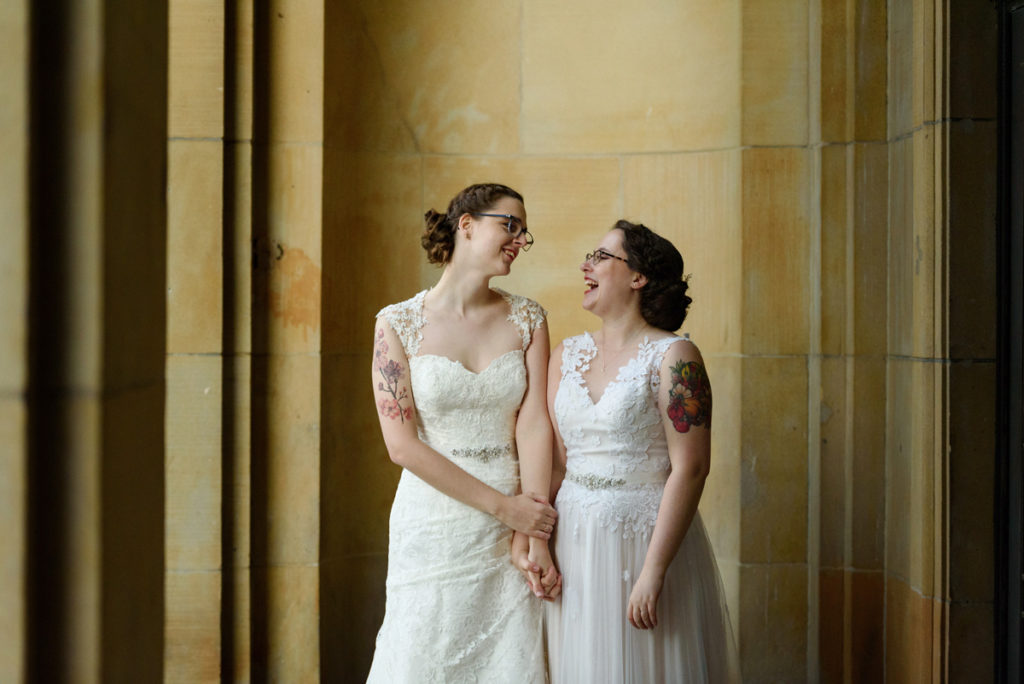 Brides holding hands in downtown Montreal