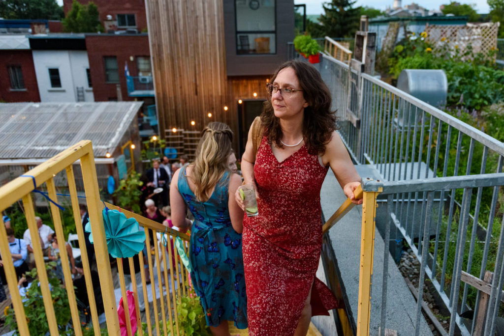 Wedding guest climbing the stairs to rooftop garden