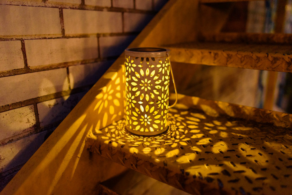 Decorative lanterns glowing to light the stairs at night