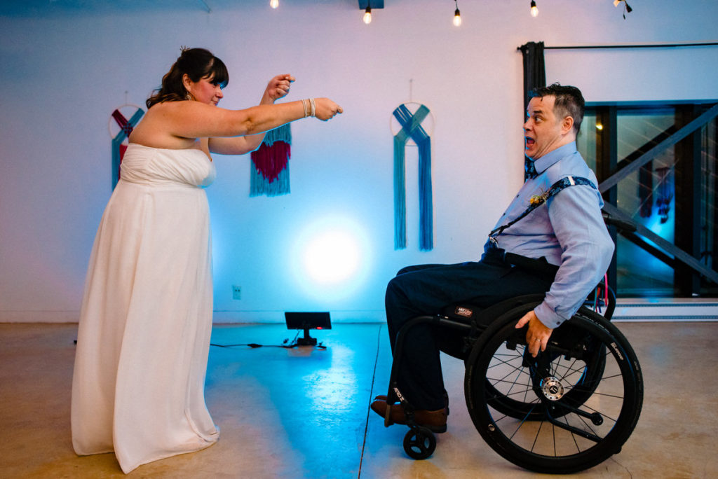 Bride reeling in the groom on the dance floor