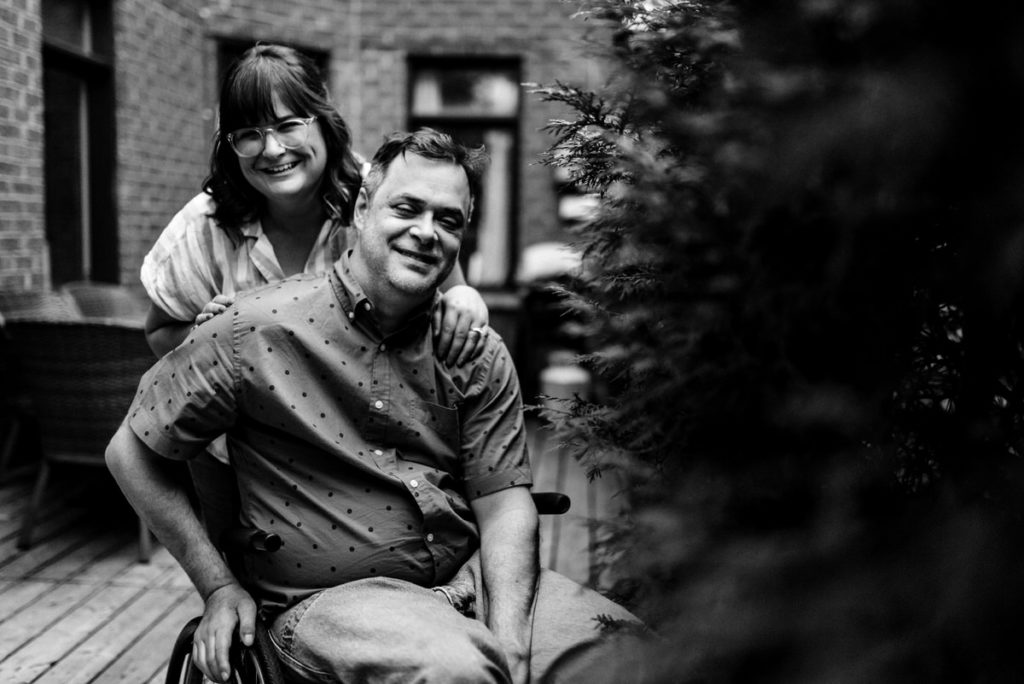 Portrait of engaged couple in their backyard