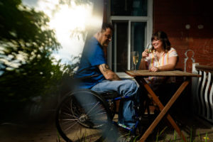 Couple enjoying champagne at sunset on their porch