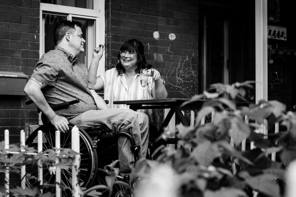 couple laughing and smiling on porch