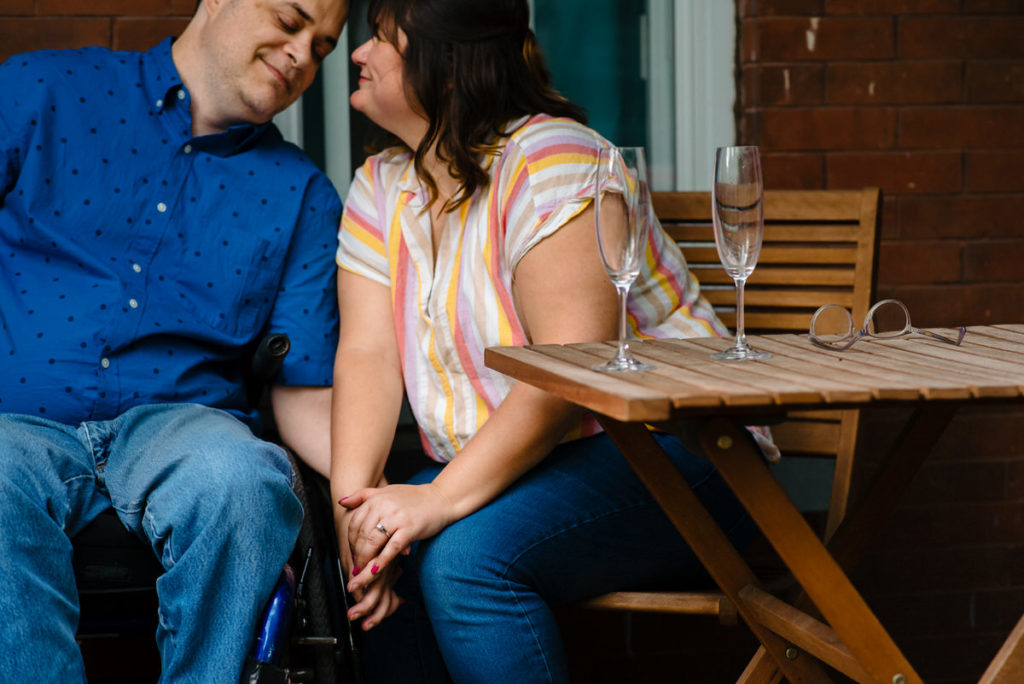 couple holding hands on their front porch