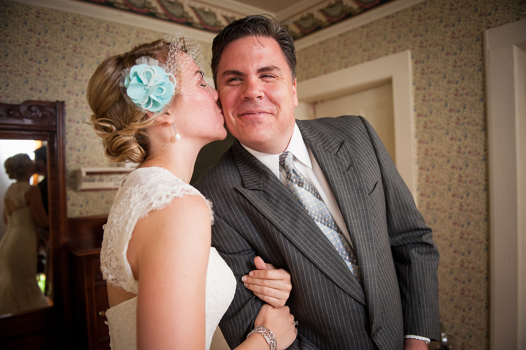 Bride kissing her dad on the cheek