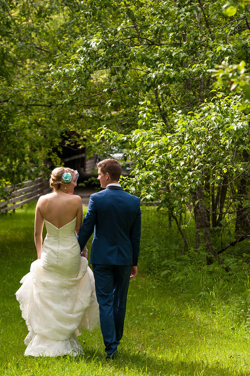 Bride and groom strolling through the woods