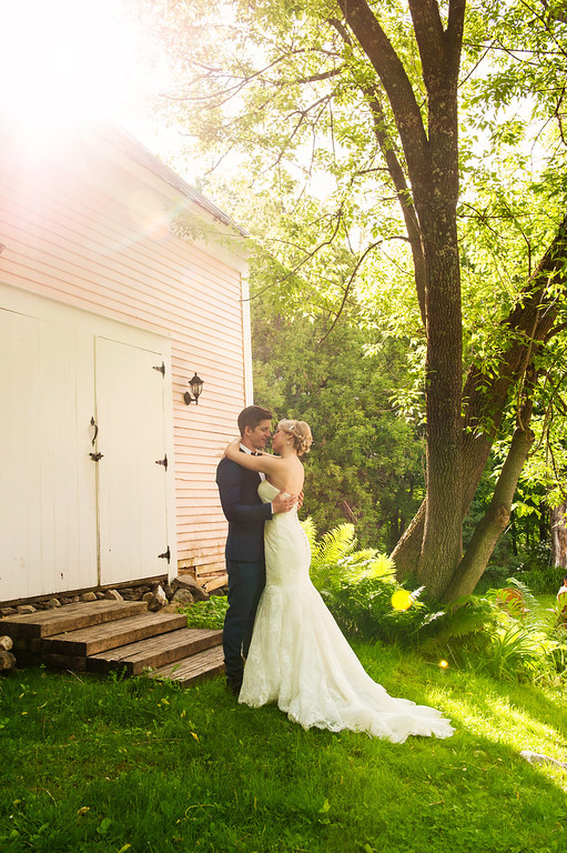 Wedding couple in back of pink house