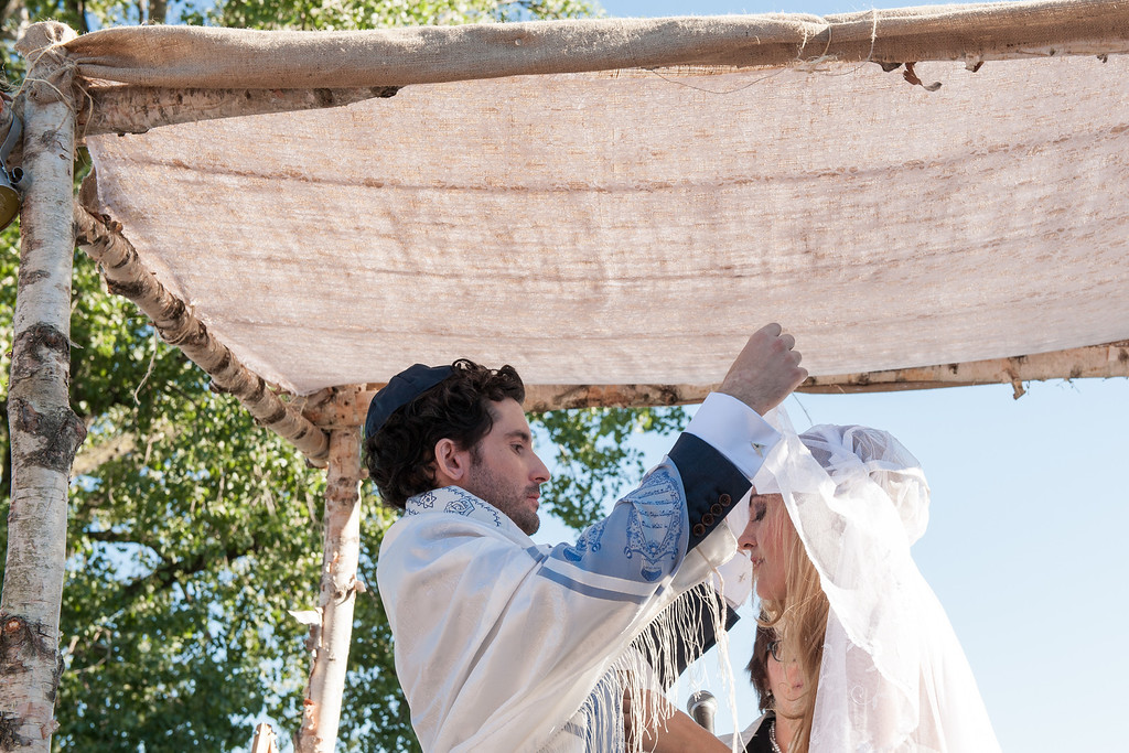 Groom lifting the bride's veil