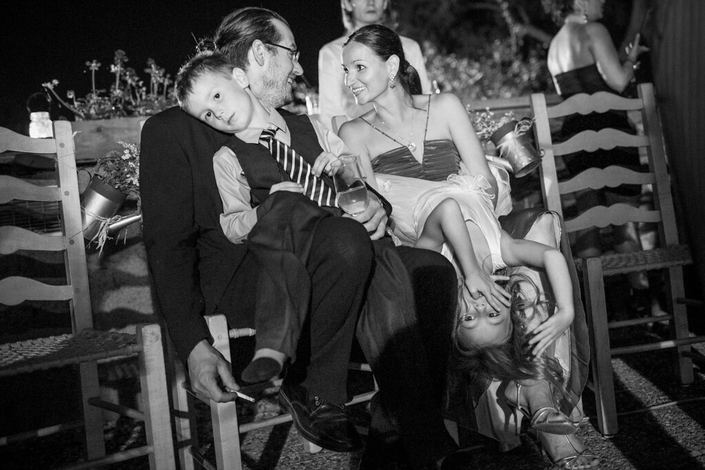 Kids sitting on parents lap at wedding reception