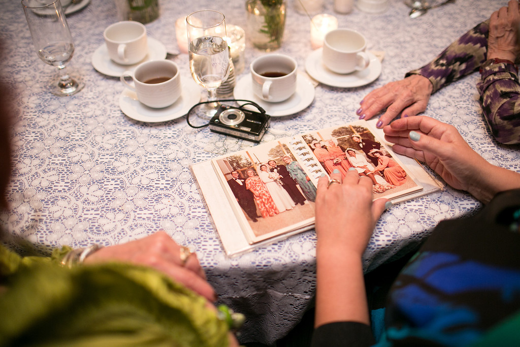 Wedding guests looking at old wedding albums